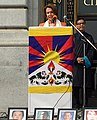 Kaydor Aukatsang (right) on 10 March 2015, from- Congresswoman Pelosi speaks at the 56th Annual Commemoration of the Tibetan National Uprising Day (16871694917) (cropped).jpg