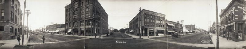 Three streets stretch off into the distance, with old style buildings, in 1907