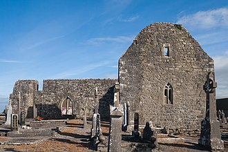 Kilmaine - Old church of Kilmaine with a 16th-century tracery window on the site of an early Christian monastery which, according to tradition, has been founded by St. Patrick. It became a prebendary church of Tuam.