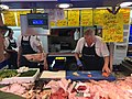 Klaas Hartevelt cutting fish on Leiden market (The Netherlands 2017) (35176901006).jpg