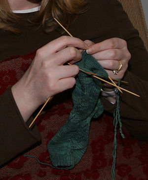 Knitting stockings on double-pointed needles. ...