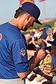 Kris Bryant signing autographs during his rehab assignment against Omaha (42507326880).jpg