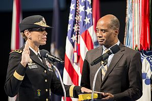 Nadja West - West takes the U.S. Army Surgeon General oath of office. Her husband, COL(Ret) Donald West, holds the Bible.