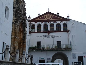 Alcalá de los Gazules - In front, the 16th-century Town Hall. On the left, Saint George's church