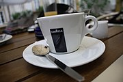 Lavazza cup with little spoon in café Pod Obrazy in Brno, Brno-City District