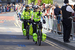 Crowd control barrier - During the 2014 London Marathon, a police officer keeps spectators behind the barrier
