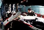 "Maj. Gualbert Sanchez checks a ""casualty"" aboard a C-141B Starlifter aircraft DF-ST-83-07286.jpg"