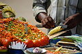 Man preparing food with Indian vegetables.jpg