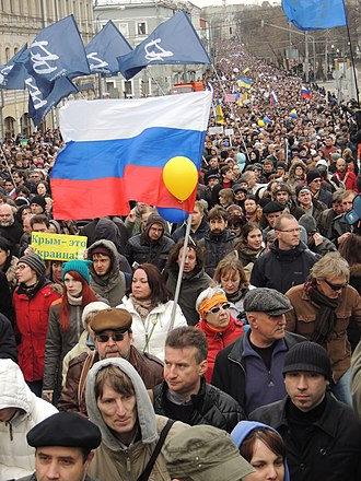 Timeline of the annexation of Crimea by the Russian Federation - Around 50,000 people rallied in Moscow protesting Russia's annexation of Crimea.