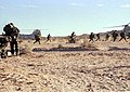 Marines from Fox Company 2-7, rush across the desert in full battle gear to their helicopters as the airborne assault part of the exercise begins. THERE IS ONLY A SCREEN RESOLUTION - DPLA - d486c80332fb0405214a55c736e341ee.jpeg