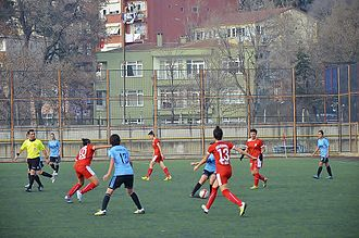 Turkish Women's First Football League - 2013–14 Women's First League match Marmara Üniversitesispor (blue/black) vs Konak Belediyespor (red)