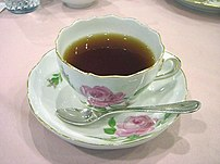 Tea in a Meißen pink-rose teacup