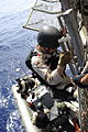 Members of a visit, board, search and seizure team from the Arleigh Burke-class guided missile destroyer USS Farragut (DDG 99) board a rigid-hulled inflatable boat to investigate a suspicious dhow off the coast 100402-N-OM347-003.jpg