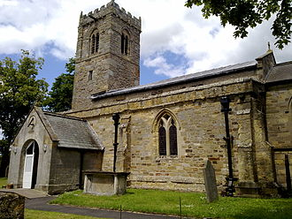 Middleton, Ryedale - St Andrew's Church. Sundial can be seen on the porch entrance
