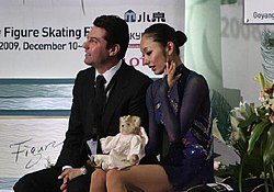 Miki Ando with Nikolai Morozov kiss & cry 2008-2009 GPF.jpg