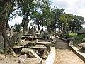 Monolith memorials under shady trees.jpg