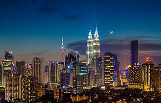 Mahathir Mohamad - Moonrise at the heart of Kuala Lumpur.