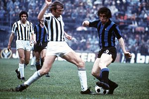 Roberto Boninsegna - Boninsegna (right) playing for Inter Milan in 1974 against his iconic rival, the juventino and future teammate Francesco Morini.