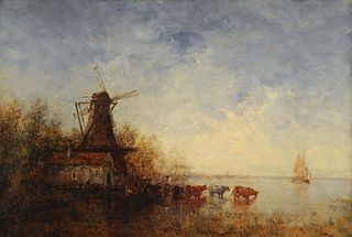 Windmill on riverbank