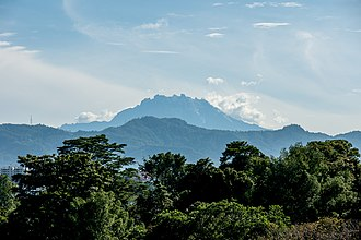 Mount Kinabalu in Malaysia, the highest summit of the island MountKinabalu from CheSuiKhorPagodaKK-01.jpg