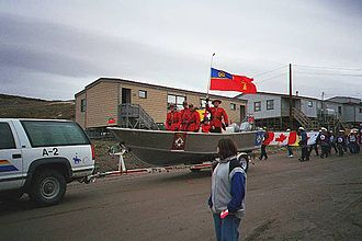 Iqaluit - The Royal Canadian Mounted Police on parade in Iqaluit, Canada Day 1999