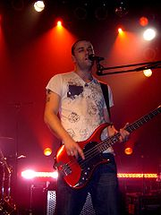 Chris Wolstenholme of Muse performing at the Mod Club Theatre, Toronto in 2004. The international Absolution tour included the band's first shows in North America since 1999.