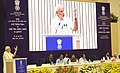 Narendra Modi addressing at the launching ceremony of the Smart Cities Mission, Atal Mission for Rejuvenation and Urban Transformation (AMRUT) and Housing for All Mission (1).jpg