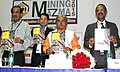 Narendra Singh Tomar releasing a book 'Mineral Concessions Framework', at the inauguration of the Mining Mazma-2015, in Bengaluru. The Secretary (Mines) Shri Balvinder Kumar and the Secretary (Coal).jpg