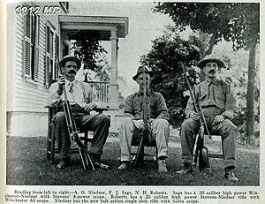 Ned H. Roberts - A.O. Neidner, F.W. Sage, and Ned H. Roberts with rifles, 1912