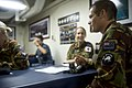 New Zealand Army Lance Cpl. Michael Noddings, right, speaks with Royal New Zealand Air Force Flight Lt. Lara Blacknore, center right, at a shipboard orientation aboard the amphibious dock landing ship USS Pearl 130603-N-WD757-087.jpg