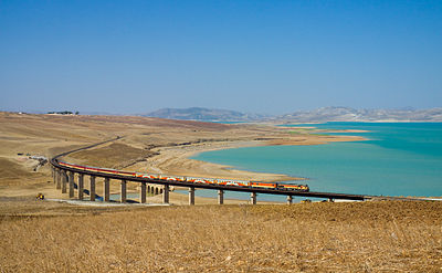 ONCF DH 370 with a Casablanca - Oujda train at the Barrage Idriss 1er.jpg