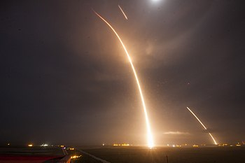 Falcon 9 Flight 20 Night Launch From Cape Canaveral Bright Line And Landing Of The First Stage Dimmer Lines On December 22 2015