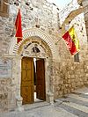 Old Jerusalem St. Mark Church with flag.jpg