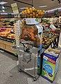 Orange juice machine in a supermarket.jpg