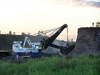 Power shovel - Shovel digging overburden.