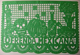 A picture of a green papel picado made for an oftenda