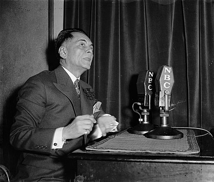Quezon broadcasting to his countrymen in Manila, from Washington, D.C., 5 April. For the first 25 minutes on air, Quezon discussed women's suffrage and urged that the 10-year independence program be limited to a shorter period, 4/5/1937. Philippine President Manuel Quezon broadcasts to home folks.jpg