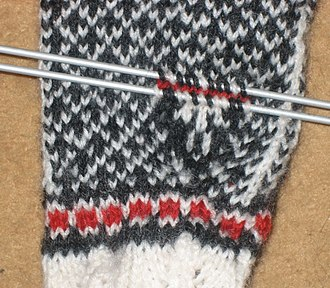 Pick up stitches (knitting) - Picking up stitches to make the thumb of a mitten.