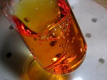 Orange liquid containing bubbles