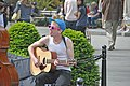 Playing the guitar in Washington Square Park DSC 0040 (5690666418).jpg