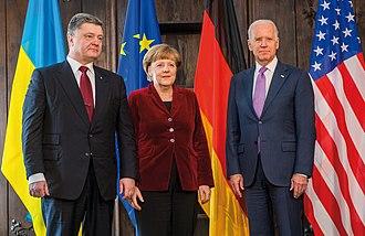 Petro Poroshenko - Poroshenko with Angela Merkel and Joe Biden, 7 February 2015.
