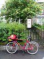 Postman's bike (9692876998).jpg