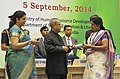 Pranab Mukherjee presenting the National Award for Teachers-2013 to Smt. Ilaben Shankarlal Panchal, Gujarat, on the occasion of the 'Teachers Day', in New Delhi. The Union Minister for Human Resource Development.jpg