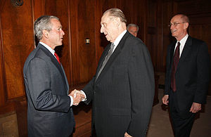 President George W. Bush (left) meets with the...