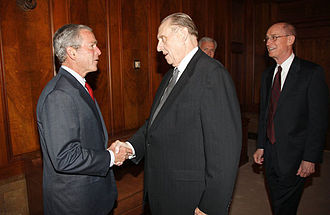 Monson, accompanied by Henry B. Eyring, shakes hands with U.S. President George W. Bush on May 29, 2008, in the Church Administration Building in Salt Lake City, Utah. President Bush meets with First Presidency of LDS church May 2008.jpg
