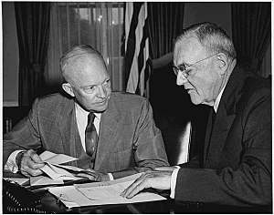 "New Look (policy) - Secretary of State John Foster Dulles, right, shown here with President Eisenhower in 1956, became identified with the doctrine of ""massive retaliation."""