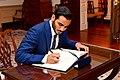 Qatari Secretary to the Emir for Investments Sheikh Mohammed bin Hamad bin Khalifa Al Thani Signs Secretary Tillerson's Guestbook Before Their Meeting in Washington (35305317066).jpg