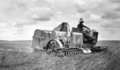 Queensland State Archives 4148 An AutoHeader at work in a badlylodged crop J Fleglers Evanslea November 1934.png