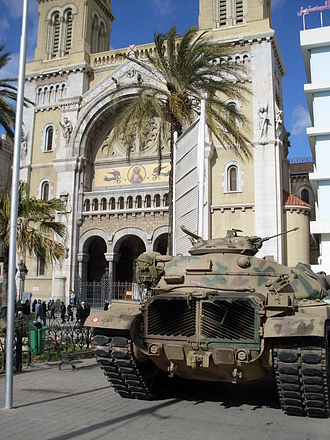 Tunisian Revolution - A Tunisian army tank deployed in front of the Cathedral of St. Vincent de Paul in Tunis