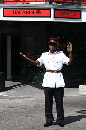 Royal Bahamas Police Force - Royal Bahamas Policeman controlling traffic in Nassau.